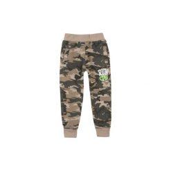 Spodnie chłopięce ze ściągaczami ocieplane, moro. Szare chinosy chłopięce TXM, moro. Za 24,99 zł.