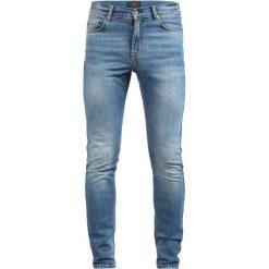 J.LINDEBERG DAMIEN HAGGARD Jeans Skinny Fit mid blue. Niebieskie jeansy męskie relaxed fit J.LINDEBERG, z bawełny. Za 509,00 zł.