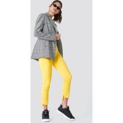 Spodnie z wysokim stanem: Trendyol Spodnie z asymetrycznymi nogawkami – Yellow