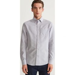 Koszula slim fit z bawełny organicznej - Niebieski. Niebieskie koszule męskie slim marki Reserved, l, z bawełny. Za 69,99 zł.