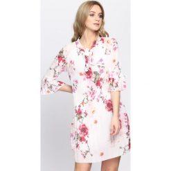 Biało-Różowa Sukienka Knowing You. Różowe sukienki marki numoco, l, z dekoltem w łódkę, oversize. Za 89,99 zł.