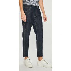 Tommy Jeans - Jeansy Carpenter. Niebieskie jeansy męskie z dziurami Tommy Jeans. Za 539,90 zł.
