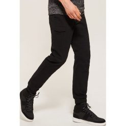 Spodnie typu jogger - Czarny. Czarne joggery męskie House. Za 119,99 zł.