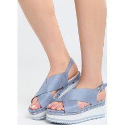 Niebieskie Sandały Smitten. Niebieskie sandały damskie Born2be, z materiału, na koturnie. Za 99,99 zł.