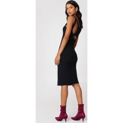 Cheap Monday Sukienka Dive - Black. Czarne sukienki dzianinowe marki Cheap Monday, z dekoltem na plecach, midi. W wyprzedaży za 80,98 zł.