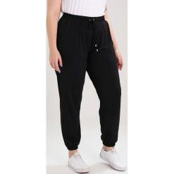 Spodnie dresowe damskie: Anna Field Curvy Spodnie treningowe black