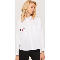 Koszula oversize Mickey Mouse - Biały. Białe koszule wiązane damskie House, l, z motywem z bajki. Za 119,99 zł.