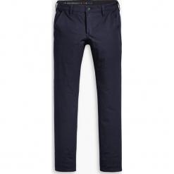 """Spodnie chino """"511® Performance"""" - Skinny fit - w kolorze granatowym. Niebieskie chinosy męskie Levi's®, z aplikacjami. W wyprzedaży za 217,95 zł."""