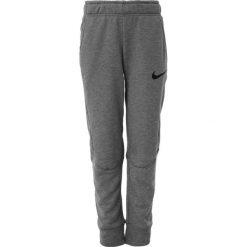 Nike Performance DRY PANT TAPER Spodnie treningowe multicolor. Szare spodnie chłopięce marki Nike Performance, z materiału. W wyprzedaży za 143,10 zł.