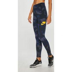 Nike Sportswear - Legginsy. Różowe legginsy marki Nike Sportswear, l, z nylonu, z okrągłym kołnierzem. Za 159,90 zł.