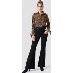 Spodnie damskie: Trendyol Spodnie dzwony z wysokim stanem - Black