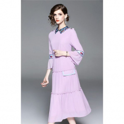 Sukienka w kolorze fioletowym. Fioletowe sukienki na komunię marki Zeraco, z dekoltem na plecach, midi, proste. W wyprzedaży za 349,95 zł.