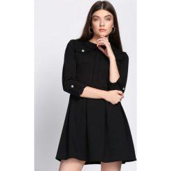 Czarna Sukienka Restrict. Czarne sukienki hiszpanki Born2be, uniwersalny, mini. Za 79,99 zł.