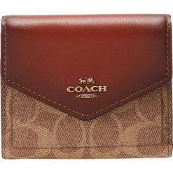 Coach COLORBLOCK SIGNATURE SMALL WALLET Portfel tan rust. Brązowe portfele damskie marki Coach. Za 399,00 zł.