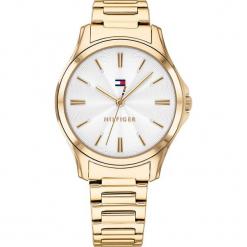 """Zegarek kwarcowy """"Lori"""" w kolorze srebrno-złotym. Żółte, analogowe zegarki damskie TOMMY HILFIGER, ze stali. W wyprzedaży za 432,95 zł."""