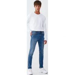 Jeansy slim comfort fit. Czarne jeansy męskie relaxed fit marki Pull&Bear, m. Za 89,90 zł.