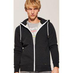 Rozpinana bluza basic - Czarny. Czarne bluzy męskie rozpinane marki KIPSTA, z poliesteru, do piłki nożnej. Za 79,99 zł.