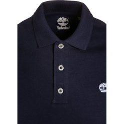 Timberland Koszulka polo blue indigo. Czerwone bluzki dziewczęce bawełniane marki Timberland. Za 149,00 zł.