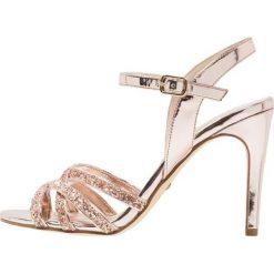 Rzymianki damskie: Buffalo Sandały na obcasie metallic glitter/rose gold