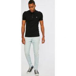 Lacoste - Jeansy. Niebieskie jeansy męskie Lacoste, z bawełny. W wyprzedaży za 269,90 zł.