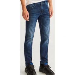 Jeansy slim fit - Granatowy. Niebieskie jeansy męskie relaxed fit marki Reserved. Za 89,99 zł.