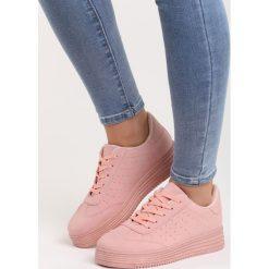 Różowe Buty Sportowe Global Spirit. Czerwone buty sportowe damskie marki KALENJI, z gumy. Za 69,99 zł.