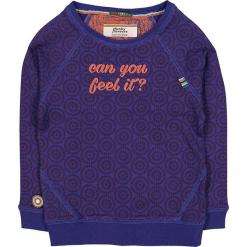 """Bluza """"Feel It"""" w kolorze fioletowym. Fioletowe bluzy dziewczęce rozpinane marki bonprix, z nadrukiem. W wyprzedaży za 102,95 zł."""