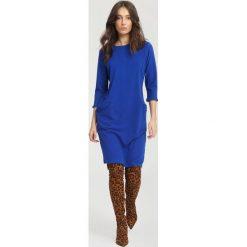 Niebieska Sukienka Docility. Niebieskie sukienki hiszpanki other, l, midi, oversize. Za 79,99 zł.