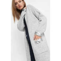 Kardigan z cekinami. Czarne kardigany damskie marki Orsay, xs, z bawełny, z dekoltem na plecach. Za 139,99 zł.