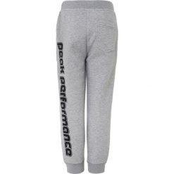 Peak Performance Spodnie treningowe medium grey melange. Szare spodnie dresowe dziewczęce Peak Performance, z bawełny. Za 249,00 zł.