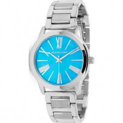"""Zegarek kwarcowy """"Hartman"""" w kolorze turkusowo-srebrnym. Szare, analogowe zegarki damskie marki Michael Kors, srebrne. W wyprzedaży za 522,95 zł."""