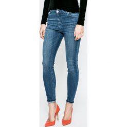 Review - Jeansy. Niebieskie jeansy damskie rurki Review, z aplikacjami, z bawełny. W wyprzedaży za 89,90 zł.