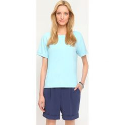 BLUZA NIEROZPINANA DAMSKA GŁADKA. Czerwone bluzy damskie marki KALENJI, z elastanu, z krótkim rękawem, krótkie. Za 59,99 zł.
