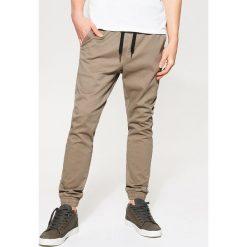 Spodnie męskie: Joggery z kieszeniami – Beżowy