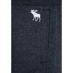 Abercrombie & Fitch CARGO Spodnie treningowe navy. Niebieskie spodnie chłopięce Abercrombie & Fitch, z bawełny. W wyprzedaży za 134,25 zł.