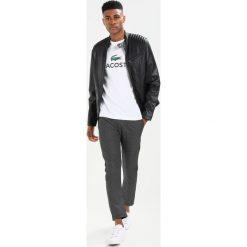 Lacoste Tshirt z nadrukiem weiss. Szare koszulki polo marki Lacoste, z bawełny. Za 219,00 zł.