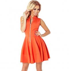 123-5 sukienka z ekspresem z przodu i kieszonkami - pomarańczowa - big. Brązowe długie sukienki numoco, l, z długim rękawem, oversize. Za 94,00 zł.