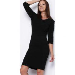 Czarna Sukienka From the Other Side. Czarne sukienki marki Born2be, l, midi, oversize. Za 69,99 zł.
