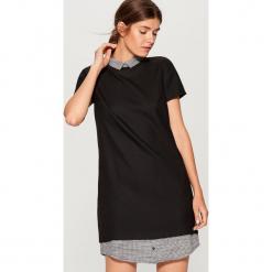 Sukienka z elementami koszulowymi - Czarny. Czarne sukienki z falbanami marki Mohito, m, z kontrastowym kołnierzykiem. W wyprzedaży za 99,99 zł.