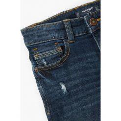 Mango Kids - Jeansy dziecięce Jacob 104-164 cm. Niebieskie jeansy chłopięce Mango Kids. W wyprzedaży za 49,90 zł.