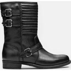 Czarne kozaki krótkie. Czarne buty zimowe damskie marki Kazar, z futra, przed kolano, na wysokim obcasie, na koturnie. Za 749,00 zł.