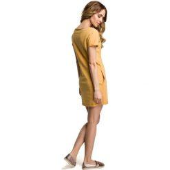 COCO Sukienka mini z naszywką - żółta. Żółte sukienki dresowe marki Moe, s, z aplikacjami, mini, dopasowane. Za 109,00 zł.