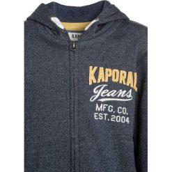 Kaporal NINO Bluza rozpinana worker melanged. Niebieskie bluzy chłopięce rozpinane Kaporal, z bawełny. W wyprzedaży za 199,20 zł.