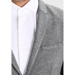 Calvin Klein BALOF DOUBLE FACE MELANGE Marynarka grey. Pomarańczowe marynarki męskie marki Calvin Klein, l, z bawełny, z okrągłym kołnierzem. W wyprzedaży za 909,35 zł.