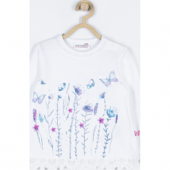 Koszulka. Białe bluzki dziewczęce bawełniane marki BUTTERFLY, z aplikacjami, z długim rękawem. Za 45,90 zł.