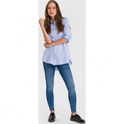 """Dżinsy """"Giselle - Super Skinny fit - w kolorze niebieskim. Niebieskie rurki damskie marki Cross Jeans, z aplikacjami. W wyprzedaży za 136,95 zł."""