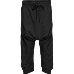 Spodnie sportowe haremki bonprix czarny. Czarne spodnie sportowe damskie marki KIPSTA, l, z bawełny, na fitness i siłownię. Za 79,99 zł.