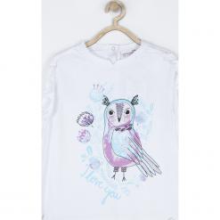 Koszulka. Białe bluzki dziewczęce bawełniane marki OWL, z falbankami, z długim rękawem. Za 49,90 zł.