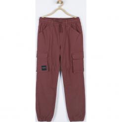 Spodnie. Brązowe chinosy chłopięce FUTURE, z bawełny. Za 99,90 zł.