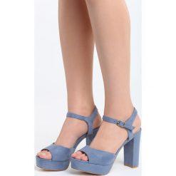 Niebieskie Sandały Stained. Niebieskie sandały damskie na słupku marki Born2be, z materiału, na wysokim obcasie. Za 44,99 zł.